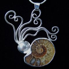 Fossil ammonite and pearl, set in sterling silver by artist Michael Kenney.