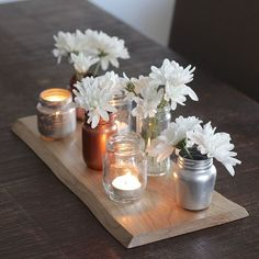 Realize you have a few too many jam and mason jars when you start running out of storage space? Don't worry, and dont throw them away . Instead turn them into this pretty upcycled glass jar centerpiece.