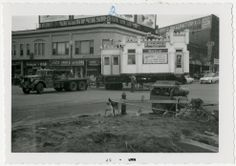Transportation of White Castle building number 15 by truck. Moving to Grant St. and Nicollet Ave. in Minneapolis, Minnesota. Photograph was taken in March of 1957. Truck pulling White Castle building reads Doepke House Movers.