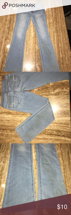 AE kick boot jeans American eagle kick boot light denim jeans. Size 4Reg. Stretchy. The left leg has a stain in the front towards the bottom that I just noticed when the flash came on while taking these pics. Feel free to ask any questions! American Eagle Outfitters Jeans Boot Cut