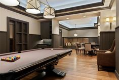 love those ceilings with a ledge for lights. love that pool table.