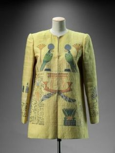 Woman's jacket with Egyptian motifs including falcons, lotuses, barque and hieroglyphs, painted silk with metallic embroidery, Mary McFadden, early 1980s, in New York, Metropolitan Museum of Art, 2010.693.