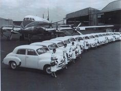 Trans Australian Airways with one of their Viscount planes and Flight Attendants with a row of Holden cars at Mascot airport, Sydney, Australia in the Australian Airlines, Australian Cars, Holden Australia, Victoria Australia, Sydney Australia, Brisbane, Melbourne, Car Facts, Attendance
