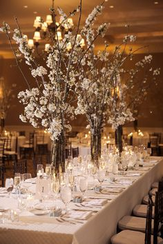 White Cherry Blossom branches as centerpieces for a winter wedding.
