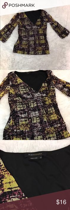 BCBG Maxazria Womens Shirt Size XS Multi Color BCBG Maxazria Womens Shirt Size XS Multi Color 1/2 Sleeve. Condition: Pre-owned. No flaws. Free from stains, holes and smells. Features: V-neck. Elbow length sleeves. Chest: 15 inches, Length: 20 inches, Sleeves: 16 inches. BCBGMaxAzria Tops Blouses