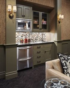 Mini kitchen for basement, perhaps under the steps?  Microwave, refrigerator, sink, open cupboard for glasses.  Really liking this design.