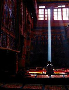 meditating in a ray of light.