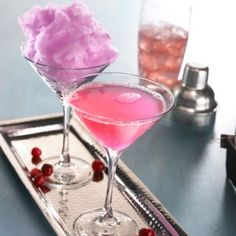 A Pink Punk Cosmo, as made so famous by TGI Fridays.  You gotta love a drink with cotton candy!