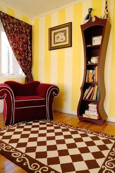 Squiggly bookshelf and over-sized chair in the Alice in Wonderland-themed big girl room