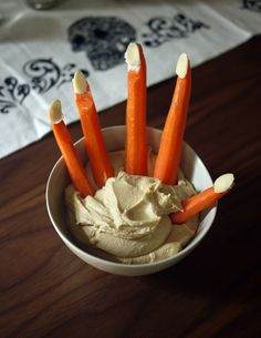 Ha, world's easiest healthy Halloween treat: Creepy carrot fingers in hummus.