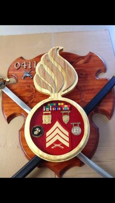 Sword holder/shadow box Questions on design or price contact Lunawood1775@gmail.com