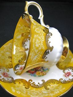 Paragon...Trenton...gold and white teacup and saucer with gold gilt scrolling...