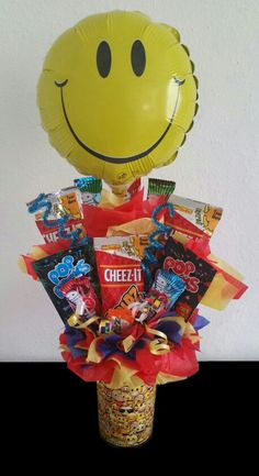 Smiley Face Candy bouquet  No matter the occasion, this Smiley Face Candy bouquet  is sure to brighten their day!  This is one sweet gift for both kids and adults. This gift is designed in emoji Cup container and is filled with a great variety of candies  they're sure to love ! For more  Find me on Facebook: Liz's Cakes & Arrangements
