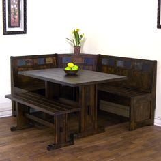 Dark wood L-shaped breakfast nook and booth with matching table
