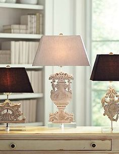 Perfect for your bedside or accent table, the Bria Lamp boasts an intricate and elegant wooden base sure to enliven any room's décor.