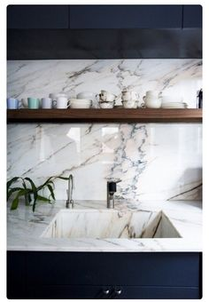gorgeous backsplash and floating shelves