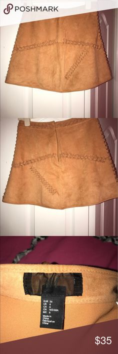 H&M Faux Suede Skirt - Sz 6 Real Suede mini skirt with cute lattice detailing. Mini Skirt, back zipper. Sits high-waisted. Worn once for vacation, looks new. H&M Skirts Mini