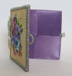 "This first needlecase has a floral design and measures 3""x 3"". It is worked on 14 mesh perforated paper with floss and 11/0 seed beads."