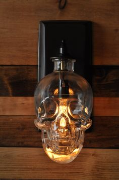 Crystal Head Vodka Decanter Cleverly Made Into A Skull Wall Sconce  #design #lighting #skull #vodka