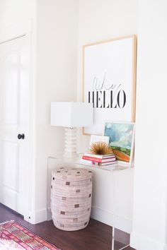 Bright and colorful entryway console table...gorgeous styling!