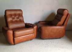 A pair of vintage French tan leatherette armchairs. Very comfortable and super stylish.Paul retrorumage@gmail.com