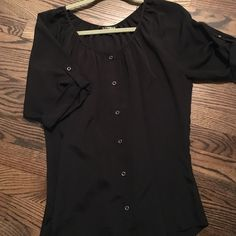 Express Black Blouse This black blouse is from Express. It is a medium. Has been worn before, but in excellent condition! A perfect blouse for work/going out! Can easily be dressed up with heels and dress pants or down with jeans. Express Tops Blouses