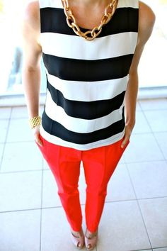 red pants, black and white tee, gold necklace
