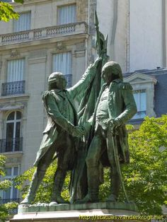 Statue of the Marquis de Lafayette and George Washington shaking hands next to the French and American flags. By Frédéric Auguste Bartholdi, sculptor of the Statue of Liberty. 1890, Paris.