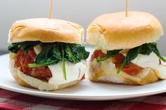 Mini chicken meatball subs? Get out.  Get the Recipe: Chicken Meatball Sliders with Wilted Spinach   - Delish.com