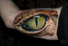 Reptile Eye Inner Bicep | Best Tattoo Ideas & Designs