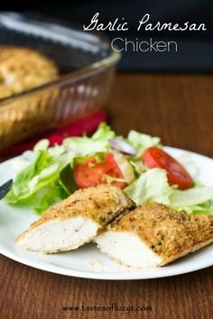 Garlic Parmesan Chicken. Chicken coated with parmesan cheese and bread crumbs with a garlic butter drizzle. So good served with spaghetti and sauce, or just on it's own!