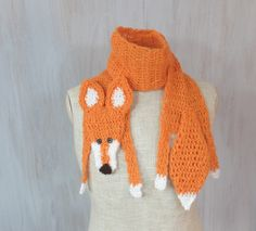 """Red fox scarf For baby Handmade soft Crochet scarf Animal scarf Orange yarn Children scarf For kid Winter gift Neck warmer Xmas gift   Very soft, nice and friendly young red fox — made by myself. It is made of orange and white yarn. This fox has embroidered mouth and button eyes. Perfect winter gift!   Length: with legs and tail: 56 (143 cm), without head, legs and tail (only """"body""""): 43 (110 cm) Width: 4 (10.5 cm)   Handmade with love in a smoke-free house.  Ready to ship.   Please check…"""