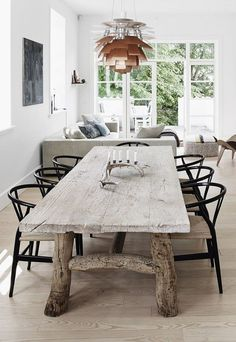 Country Modern Dining - love the rustic wood table combined with the Poulsen Artichoke light & Wegner's Wishbone chair