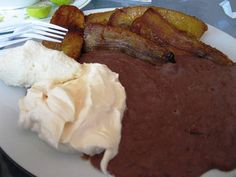 An El Salvador breakfast, including refried beans, queso fresco (fresh cheese) and fried plantains.