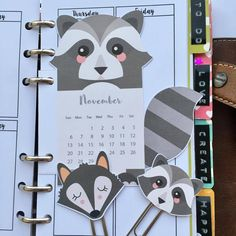 Free printable monthly calendar divider + matching DIY paperclips for your planner : cute racoon planner inserts