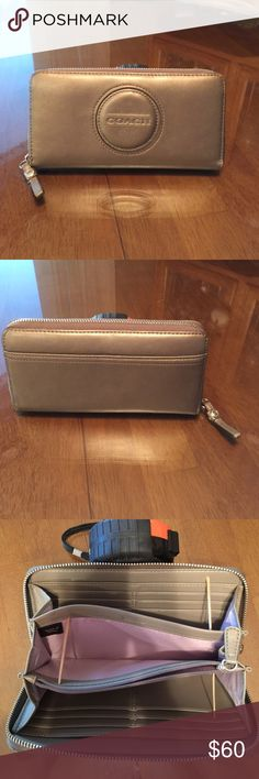 Coach Wallet - Bronze Coach Wallet, Bronze color, has 16 card slots with 1 zipper compartment for bill or coins & 5 additional areas for items to be used. Zipped closure on the outside, Great condition, never used, received as a gift 🎁. Coach Bags Wallets