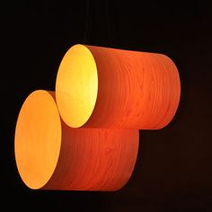 A pair of Light Tubes made ​​of two cylindrical veneer shades in a simple minimalistic line. Two different sized lampshades hanging horizontally, leaning on each other or kissing each other. Unlike most hanging lamps, Light Tube is open on its sides, it gives a twist and creates a warm atmosphere. http://www.mavestore.com/product/pair-veneer-light-tubes