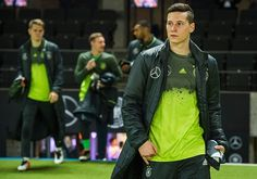 Germany's forward Julian Draxler and team mates arrive for the friendly football match Germany v England at the Olympic Stadium in Berlin on March 26...