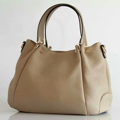 an elegant and capient bag with so much space and pockets to carry all what you need in your day