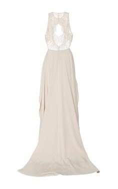 This **Georges Hobeika** gown features a high neck, a fitted bodice with sequin embellishment, a peplum detail at the waist, and a full tulle skirt.