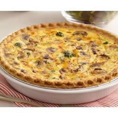 Easiest Quiche ever!  5 Egg + 1/3c Miracle Whip + 3c Veggies == into premade pie shell.  375 x 40min