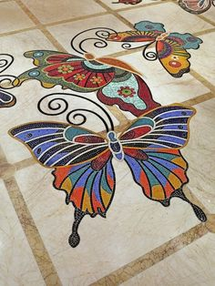 The rotunda outside The Wynn Theater has 39 crystal-encrusted butterflies hanging from the ceiling that are covered with 8 million multi-colored gems. Marble Mosaic, Mosaic Glass, Stained Glass, Glass Art, Butterfly Mosaic, Mosaic Birds, Mosaic Crafts, Mosaic Projects, Mosaic Designs