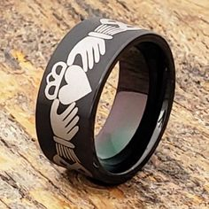 Purchase the black brushed Triclops Ring at Forever Metals. The classic design features the best friend Claddagh symbol. Claddagh Symbol, Claddagh Rings, Celtic Knot Ring, Celtic Rings, Promise Rings For Guys, Rings For Men, Black Tungsten Rings, Celtic Wedding, Tungsten Wedding Bands