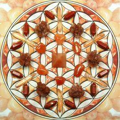This grid is for the Sacral Chakra and contains Orange Aventurine, Carnelian, Aragonite, Red Jasper, and Tangerine Aura Quartz.  .