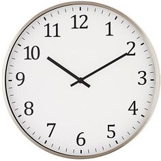 The simple design of the round metal wall clock is subdued enough to blend well in a variety of home decor styles.