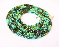 Beaded Crochet Rope Necklace - Beadwork - Seed beads jewelry - Elegant - Geometric  - Patchwork - Green - Olive green - Turquoise. $85.00, via Etsy.