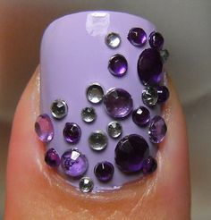 Purple nail with stickers