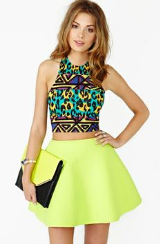 Aztec print top paired with a neon yellow skirt. Relaxed spring and summer look.
