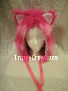 Fluffies fluffie furry hot pink and light pink cheshire cat hat, great for raves or festivals.. $25.00, via Etsy.