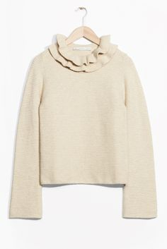 SHOPPING FIX Your autumn jumper update: Part Little House On The Prairie, part Sloane Ranger, ruffle jumpers are the newest way to insulate yourself